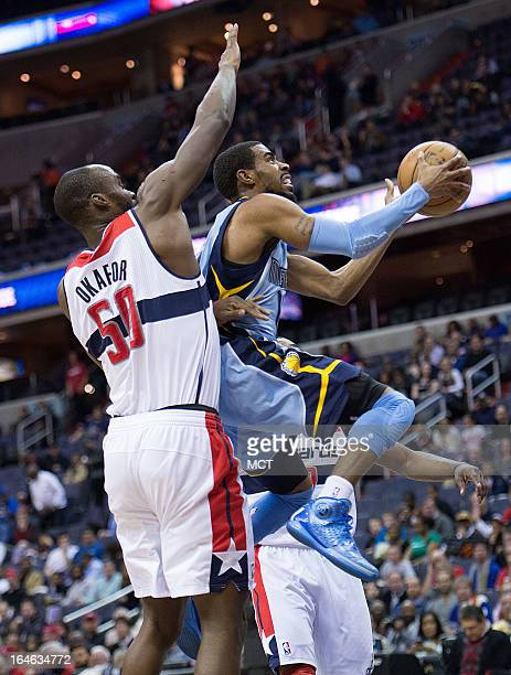 Memphis Grizzlies point guard Mike Conley drives to the basket for a shot past Washington Wizards center Emeka Okafor during the first half of their...