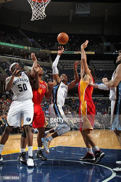 Memphis Grizzlies point guard Mike Conley fights for the ball control during the game against the Houston Rockets on January 21 2011 at FedExForum in...