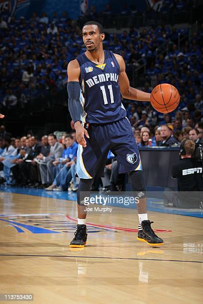 Memphis Grizzlies point guard Mike Conley handles the ball in Game one of the Western Conference Semifinals against the Oklahoma City Thunder in the...