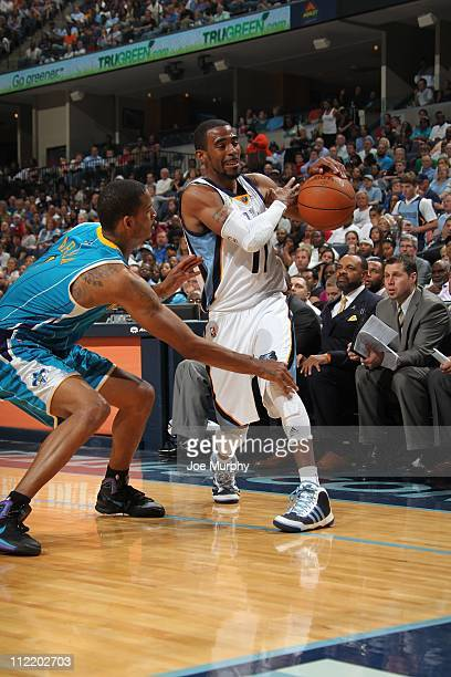 Memphis Grizzlies point guard Mike Conley protects the ball during the game against the New Orleans Hornets on April 10 2011 at FedExForum in Memphis...