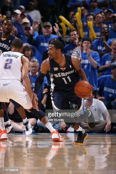 Memphis Grizzlies point guard Mike Conley protects the ball in Game one of the Western Conference Semifinals against the Oklahoma City Thunder in the...