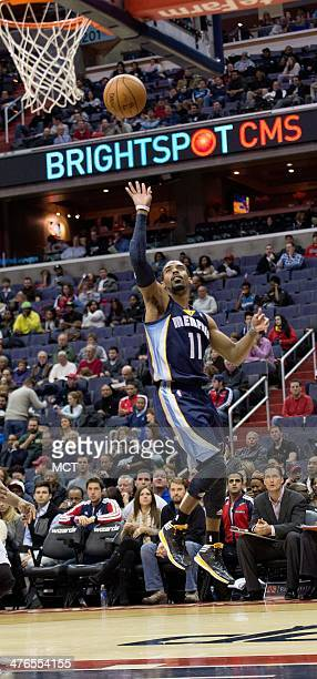 Memphis Grizzlies point guard Mike Conley scores against the Washington Wizards during the first half of their game played at the Verizon Center in...