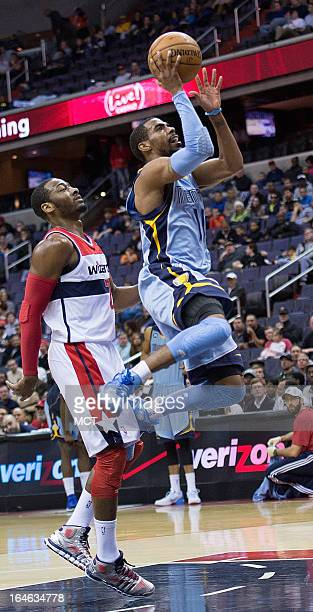Memphis Grizzlies point guard Mike Conley scores in front of Washington Wizards point guard John Wall during the first half of their game played at...