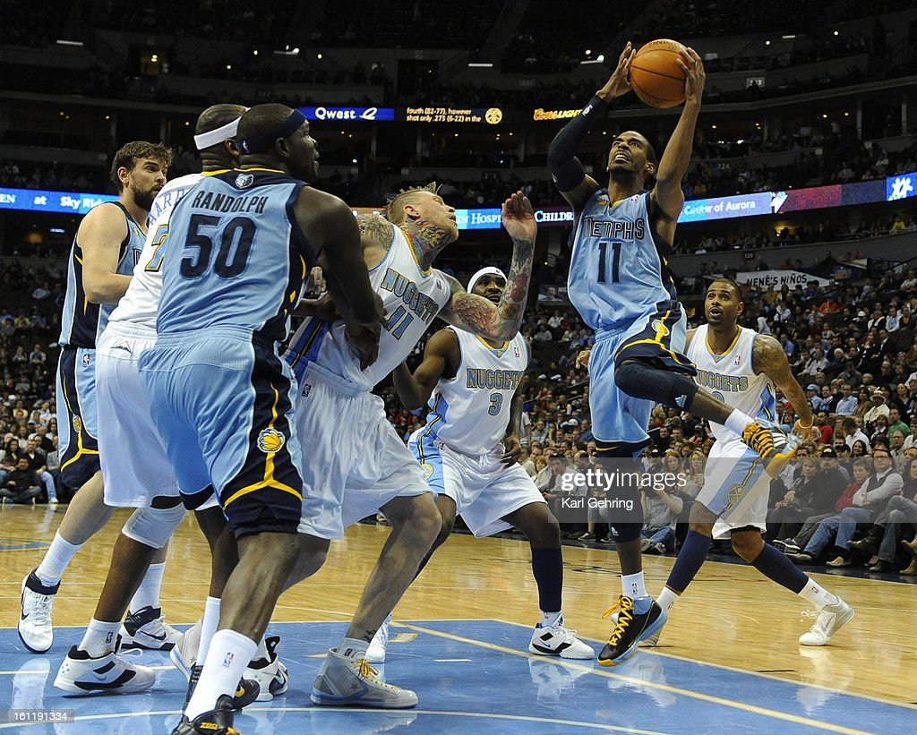 Memphis Grizzlies point guard Mike Conley (11) went to the hoop in the first half. The Denver Nuggets hosted the Memphis Grizzlies at the Pepsi Center Tuesday night, February 22, 2011. Photo by Karl Gehring, The Denver Post : News Photo