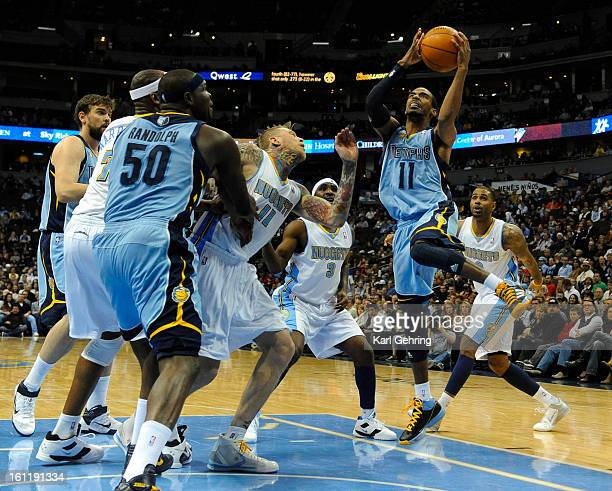 Memphis Grizzlies point guard Mike Conley went to the hoop in the first half The Denver Nuggets hosted the Memphis Grizzlies at the Pepsi Center...