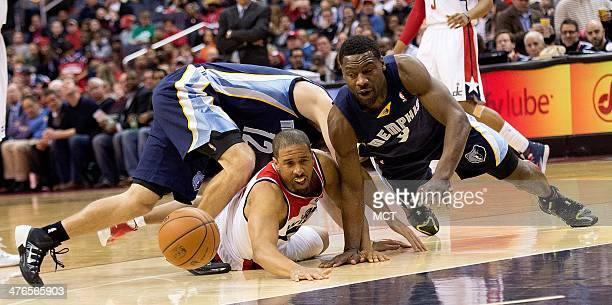 Memphis Grizzlies shooting guard Nick Calathes shooting guard Tony Allen and Washington Wizards point guard Andre Miller center scramble for the ball...
