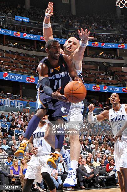 Memphis guard Mike Conley runs into Orlando center Marcin Gortat during the Magic's 8972 victory over the Grizzlies at Amway Center in Orlando...