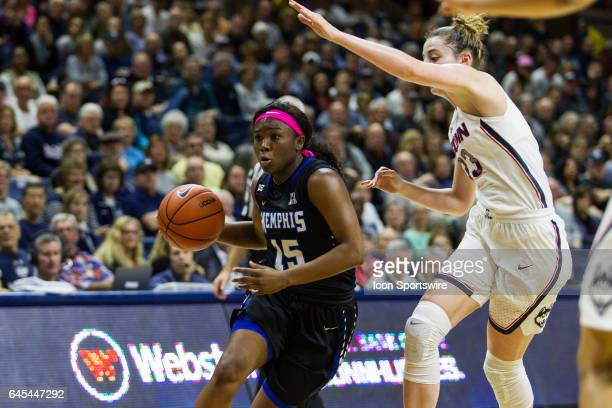 Memphis' Guard Taylor Barnes works around UConn Huskies Guard/Forward Katie Lou Samuelson during the first half of a women's division 1 basketball...
