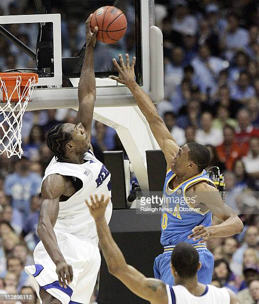 Memphis' Joey Dorsey, left, blocks the shot of UCLA's Russell Westbrook, right, near Memphis' Derrick Rose, front, during the second half of an NCAA...