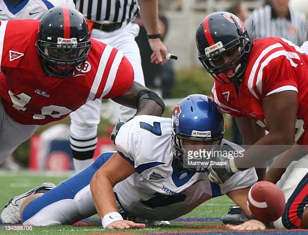 Memphis quaterback Will Hudgens fumbles while Ole Miss lineback Patrick Willis picks up the ball at VaughtHemingway Stadium on September 3 2006
