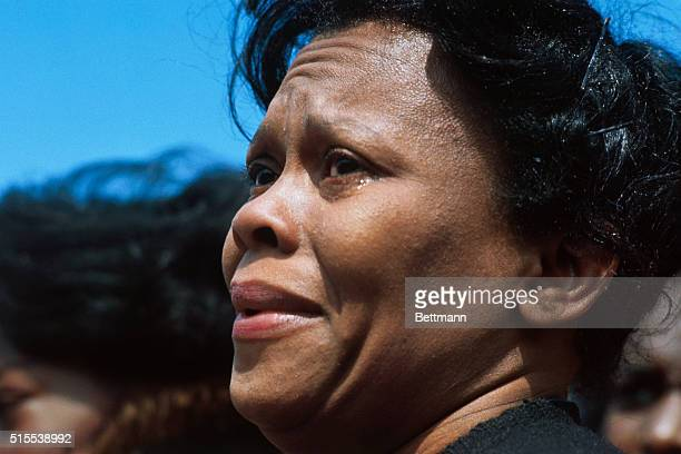 An unidentified woman has difficulty holding back her tears as she watches the casket of slain Civil Rights leader Dr Martin Luther King Jr put...