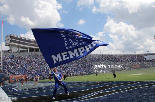 Memphis Tigers cheer squad waves a school flag after scoring a touchdown against the UCLA Bruins on September 16 2017 at Liberty Bowl Memorial...