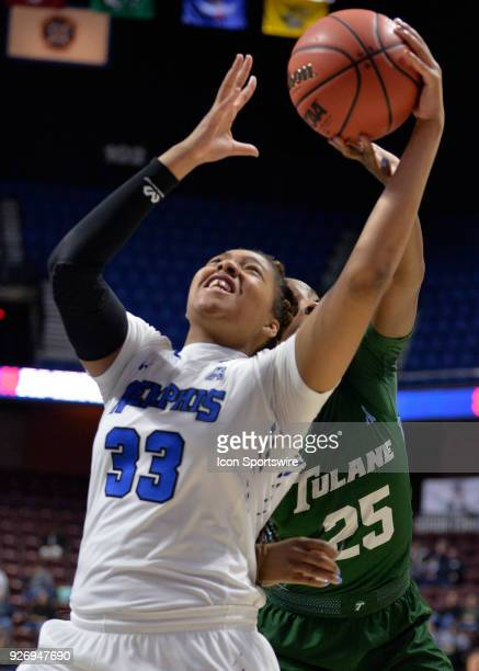 Memphis Tigers Forward Alana  Davis and Tulane Green Wave Center Harlyn Wyatt battle for the rebound during the game as the Memphis Tigers take on...