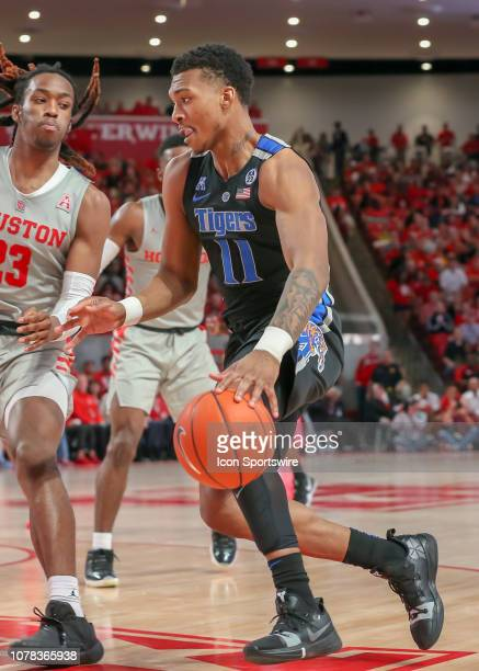 Memphis Tigers guard Antwann Jones drives the ball past Houston Cougars forward Cedrick Alley Jr during the basketball game between the Memphis...