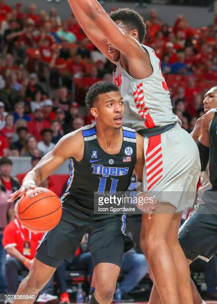 Memphis Tigers guard Antwann Jones drives the ball past Houston Cougars forward Fabian White Jr during the basketball game between the Memphis Tigers...