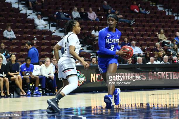 Memphis Tigers guard Gazmyne Herndon drives to the basket against Cincinnati Bearcats guard Antoinette Miller during the women's American Athletic...