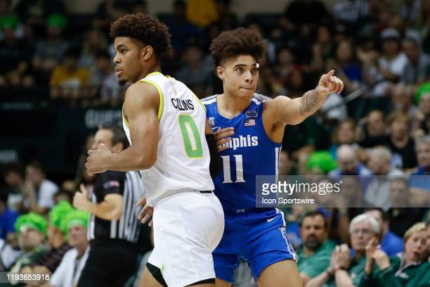 Memphis Tigers guard Lester Quinones points after making a basket over South Florida Bulls guard David Collins during the college basketball game...