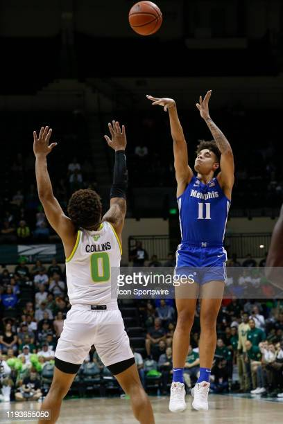 Memphis Tigers guard Lester Quinones takes a shot over South Florida Bulls guard David Collins during the college basketball game between the Memphis...