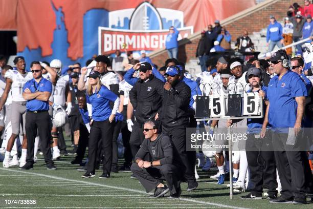 Memphis Tigers head coach Mike Norvell and the rest of the team watch from the sidelines during the Birmingham Bowl between the Memphis Tigers and...