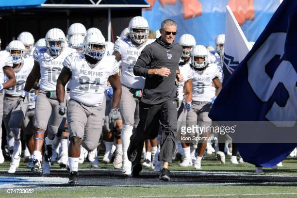 Memphis Tigers head coach Mike Norvell leads the Memphis Tigers onto the field forthe Birmingham Bowl between the Memphis Tigers and the Wake Forest...