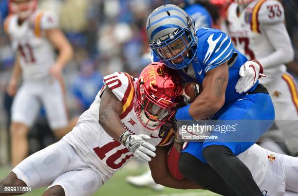Memphis Tigers kick returner Tony Pollard is wrapped up by an Iowa State defender and defensive back Brian Peavy during the second quarter during the...