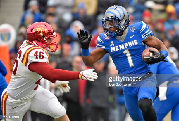 Memphis Tigers kick returner Tony Pollard tries to avoid Iowa State Cyclones defensive end Spencer Benton during the second quarter during the...