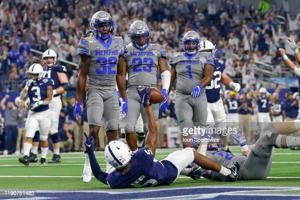 Memphis Tigers players look at Penn State Nittany Lions wide receiver Jahan Dotson after he scores a touchdown during the Cotton Bowl Classic between...