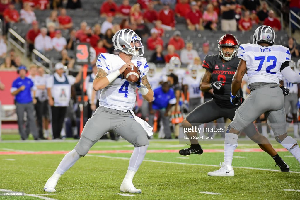 Memphis Tigers quarterback Riley Ferguson (4) looks to pass downfield during the football game between the Memphis Tigers and the Houston Cougars on October 19, 2017 at TDECU Stadium in Houston, Texas.