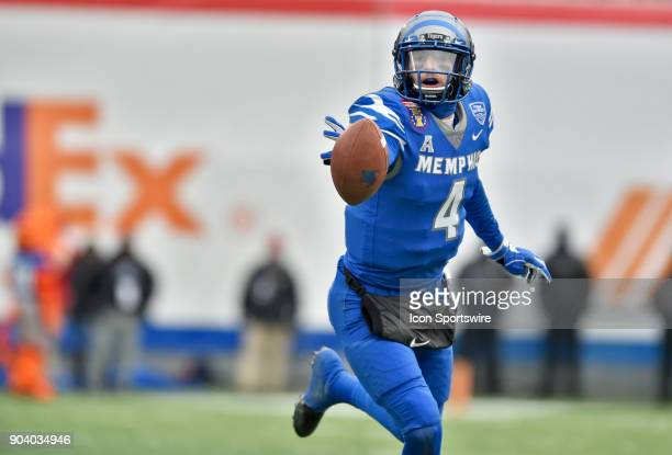 Memphis Tigers quarterback Riley Ferguson pitches the ball during the second quarter of a NCAA college football game against the Iowa State Cyclones...