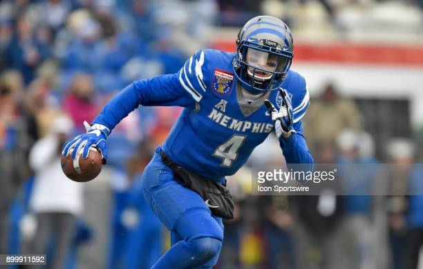 Memphis Tigers quarterback Riley Ferguson rolls out during the second quarter during the AutoZone Liberty Bowl game between the Memphis Tigers and...