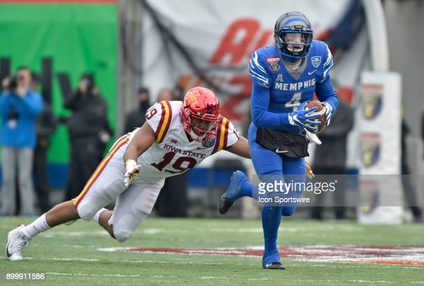 Memphis Tigers quarterback Riley Ferguson tries to outrun Iowa State Cyclones defensive end JaQuan Bailey during the second quarter during the...