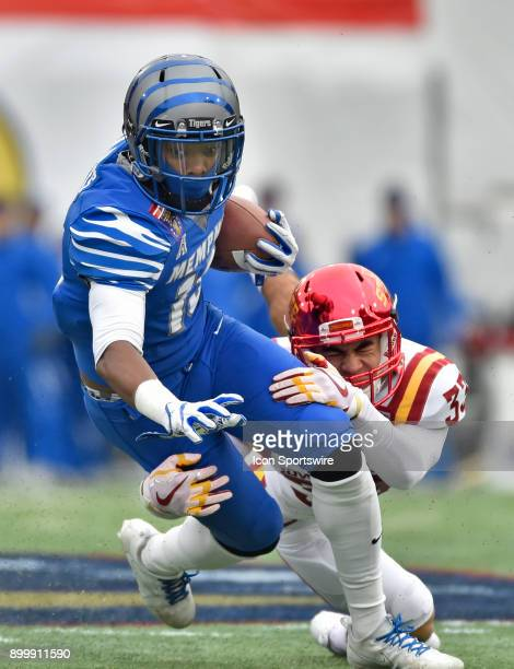 Memphis Tigers receiver Kedarian Jones is wrapped up by Iowa States Cyclones defensive back Braxton Lewis during the second quarter during the...