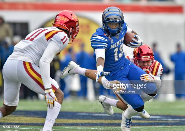 Memphis Tigers receiver Kedarian Jones tries to break free of an Iowa State Cyclones defender during the second quarter during the AutoZone Liberty...