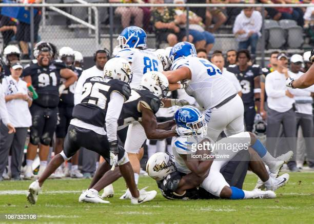 Memphis Tigers running back Darrell Henderson gets tackled by UCF Knights linebacker Nate Evans during the AAC Championship football game between the...