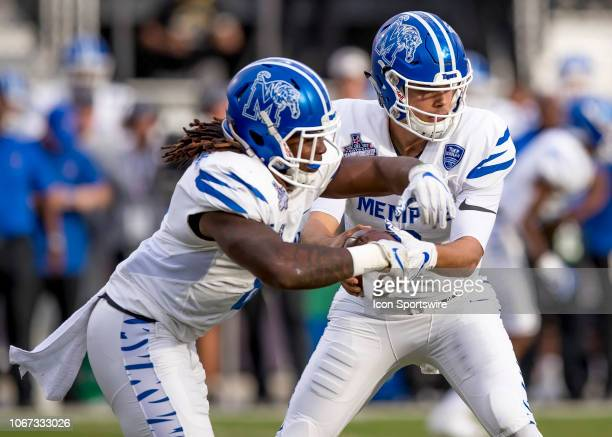 Memphis Tigers running back Darrell Henderson takes the handoff from DUPLICATE***Memphis Tigers quarterback Brady White during the AAC Championship...