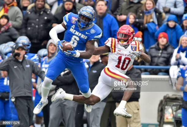 Memphis Tigers running back Patrick Taylor comes down with a catch amongst Iowa State Cyclones cornerback Brian Peavy during the first quarter during...