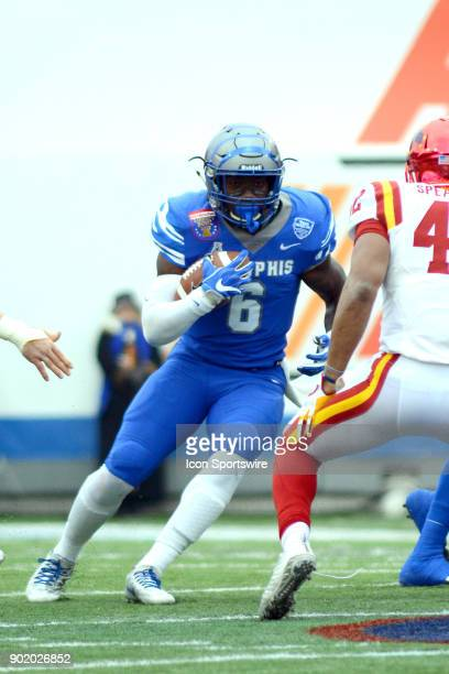 Memphis Tigers running back Patrick Tyler rushes during the AutoZone Liberty Bowl game between the Memphis Tigers and the Iowa State Cyclones on...