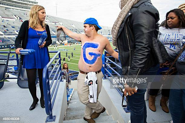 Memphis Tigers student directs students where to sit before a game against the Ole Miss Rebels at Liberty Bowl Memorial Stadium on October 17 2015 in...