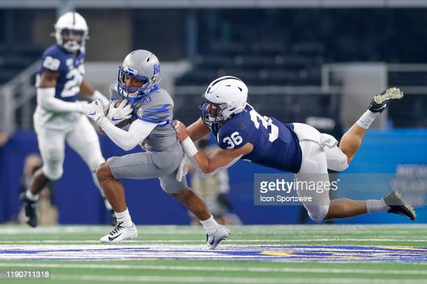 Memphis Tigers wide receiver Calvin Austin III breaks free from a tackle attempt by Penn State Nittany Lions linebacker Jan Johnson during the Cotton...