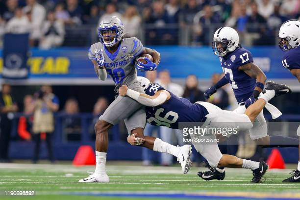 Memphis Tigers wide receiver Damonte Coxie makes a reception with Penn State Nittany Lions safety Dylan Farronato in coverage during the Cotton Bowl...