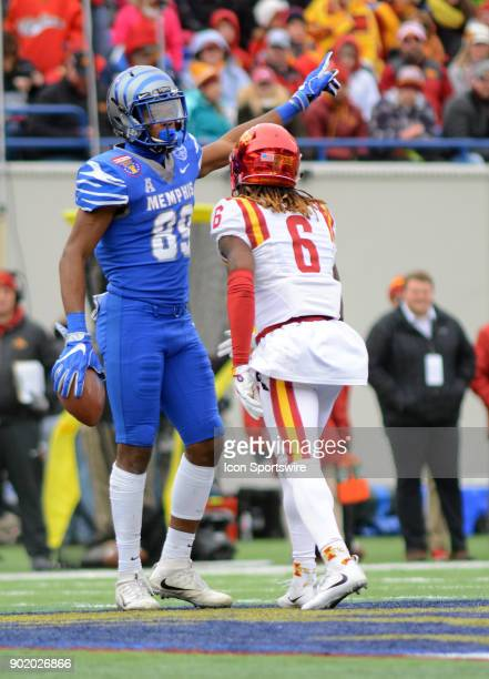 Memphis Tigers wide receiver Phil Mayhue points to Iowa State Cyclones defensive back De'Monte Ruth his sideline during the AutoZone Liberty Bowl...