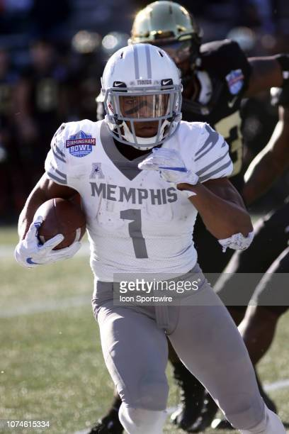 374aa5020 Memphis Tigers wide receiver Tony Pollard carries the ball during the  Birmingham Bowl between the Memphis