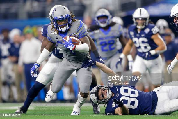 Memphis Tigers wide receiver Traveon Samuel breaks through a tackle during the Cotton Bowl Classic between the Memphis Tigers and Penn State Nittany...