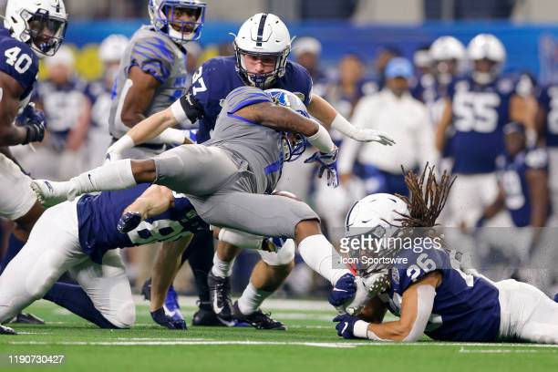 Memphis Tigers wide receiver Traveon Samuel is hit in the backfield by Penn State Nittany Lions safety Jonathan Sutherland during the Cotton Bowl...