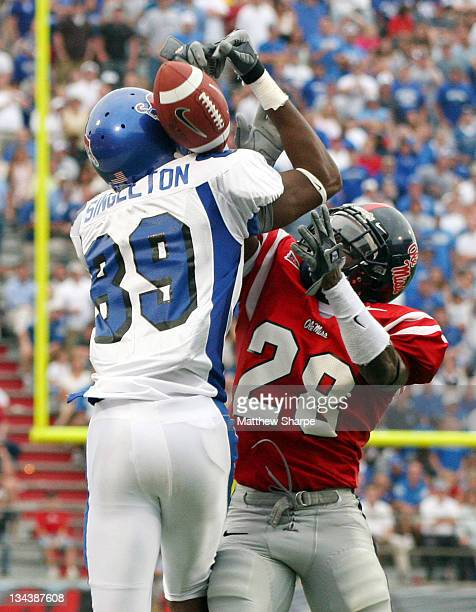 Memphis wide receiver Carlos Singleton juggles an incomplete pass while Ole Miss defensive back Nate Banks attempts to knock the ball away at...