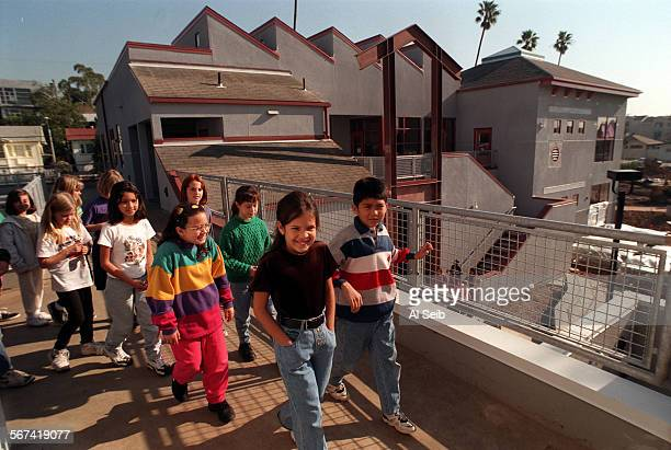 MEMuir#1AS1–9–97A Santa Monica CA Students from Anita Clark's 3rd and 4th grade class on the new campus of John Muir Elementary School a state of the...