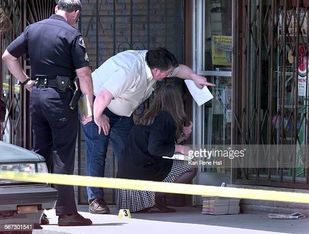 MEMurderdoorD060498KRH––Jim Conley supervisor of the forensics detail and Leslie Meader coroner investigator look in the door of the Beer and Wine...