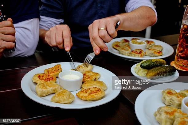 Men about to eat Pierogi