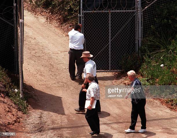 Men adjust gates at the site of Jennifer Aniston and Brad Pitt''s wedding July 27 2000 in Malbu CA It was reported that they will be married this...