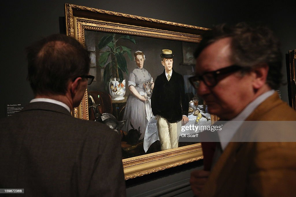 Men admire the painting by Edouard Manet entitled 'The Luncheon' in the Royal Academy of Arts on January 22, 2013 in London, England. The painting features in the Royal Academy's new exhibition 'Manet: Portraying Life' which displays over 50 paintings spanning his career. The exhibition open to the general public on January 26, 2013 and runs until April 14, 2013.